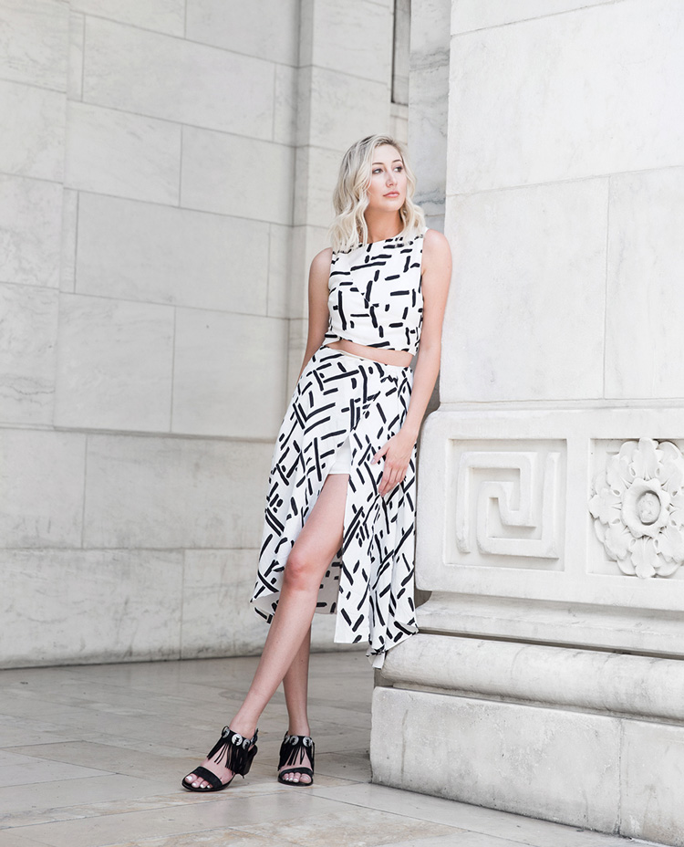 Carly Cristman wears Line & Dot crop top and skirt with Sol Sana sandals
