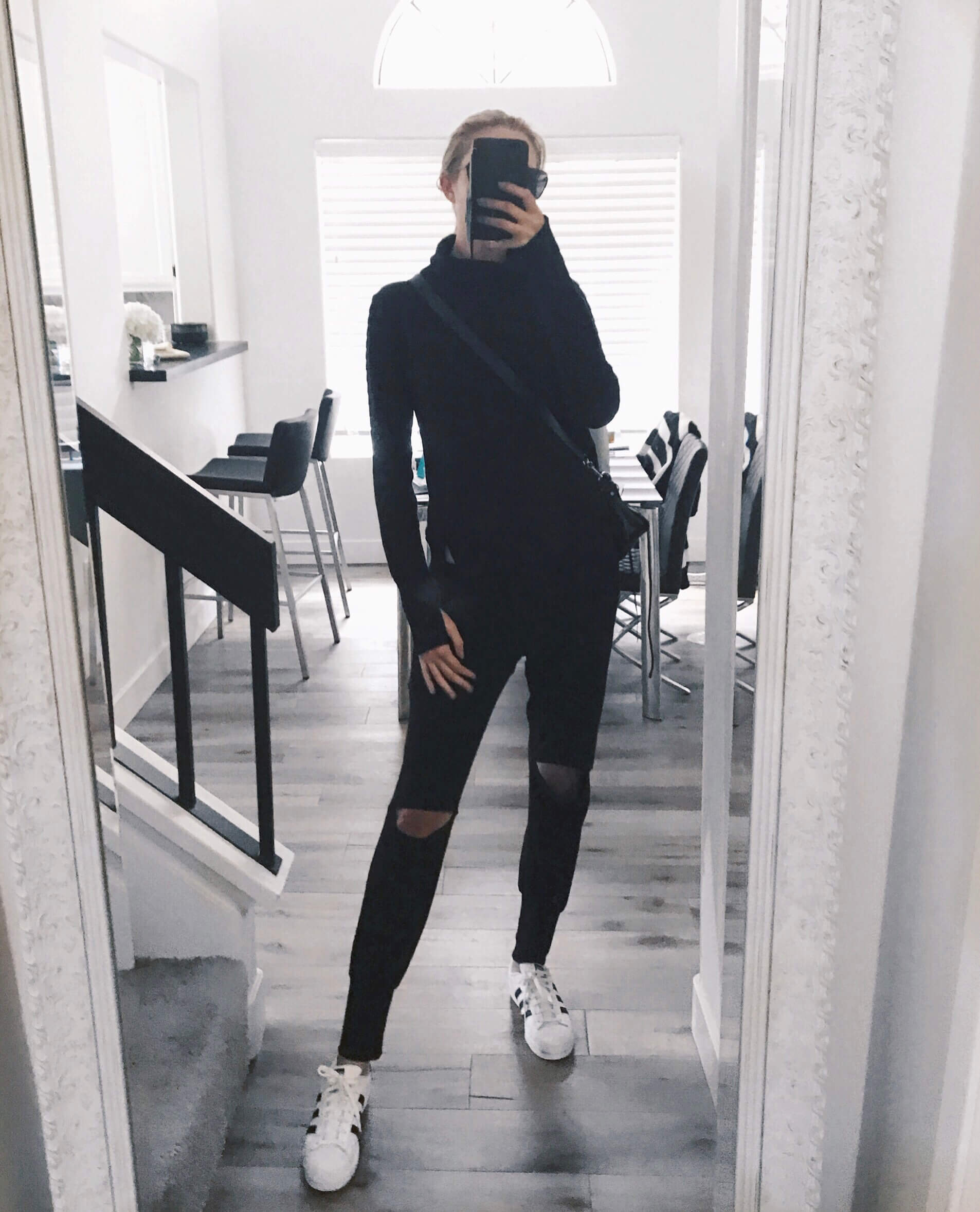 Carly Cristman wearing athleisure style - Alo Yoga and nesh nyc sweatpants and adidas superstars