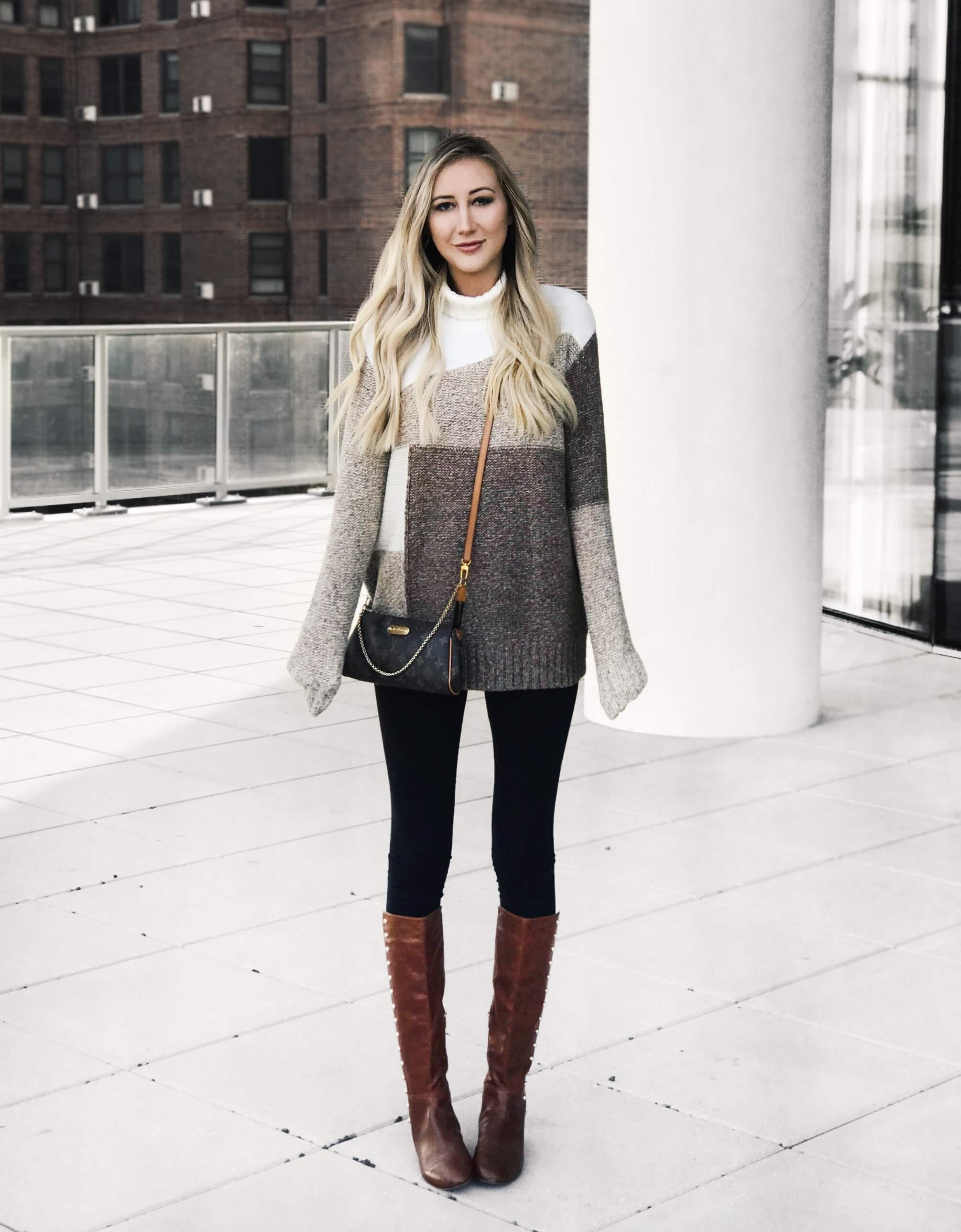 Carly Cristman fall wardrobe essentials, colorblock sweater, patchwork sweater, neutral tone sweater, brown boots, knee high boots