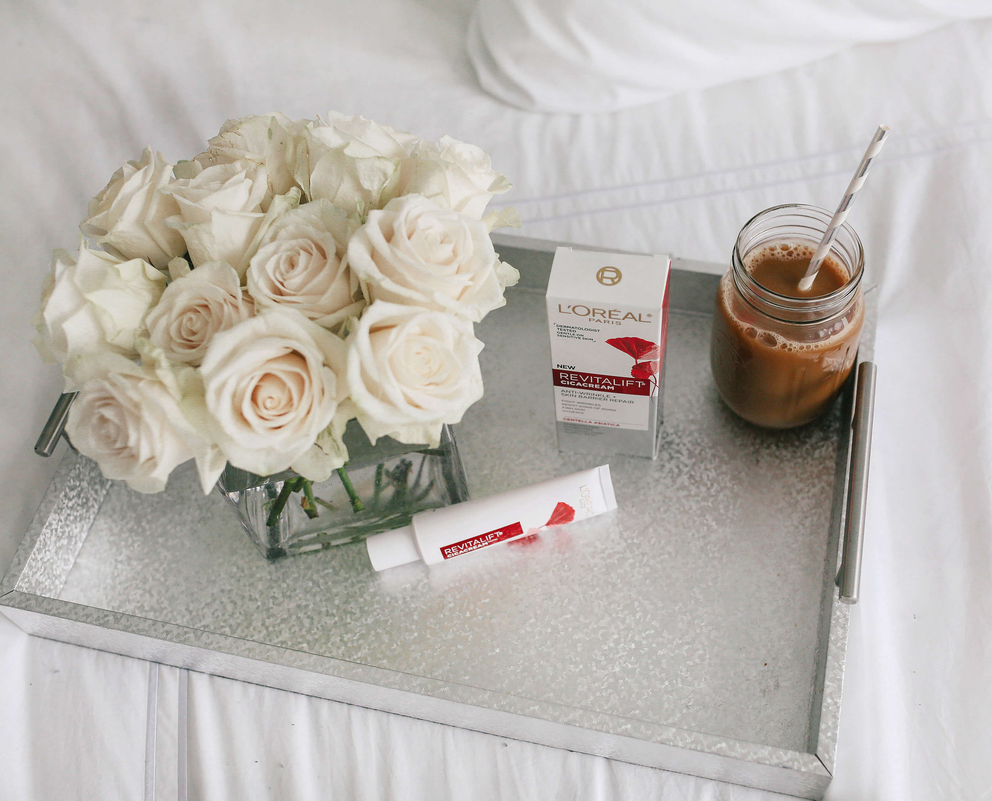 Carly Cristman morning routine, minimalist bedroom, Anti-Aging Morning Skincare Routine, L'Oreal Revitalift Cicacream