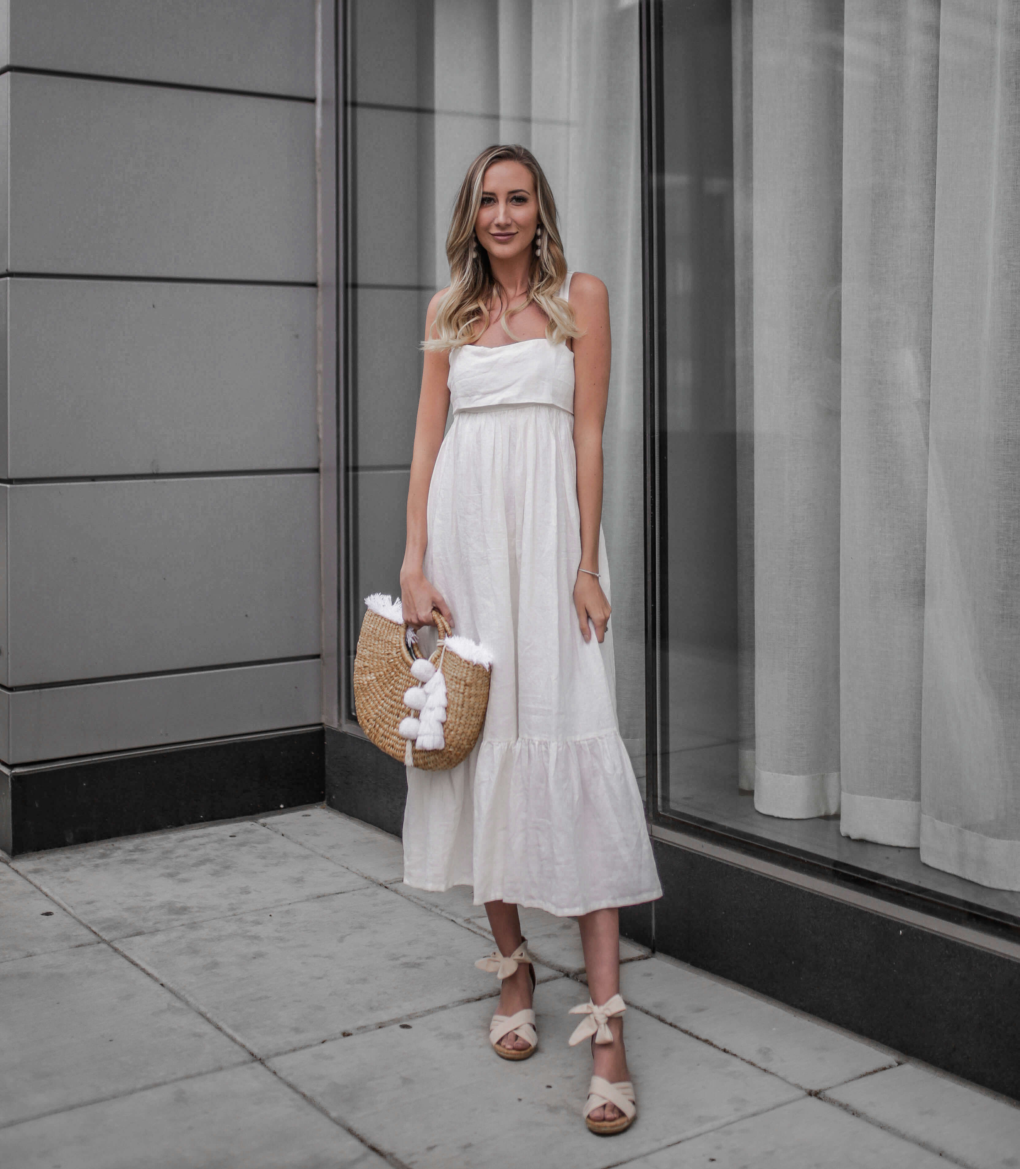 Carly Cristman wearing a summer linen dress with wedges, Summer Trends 2018, CAARA Forget Me Not Linen Midi Dress, UGG Traci Espadrille Wedge Sandal, basket bag