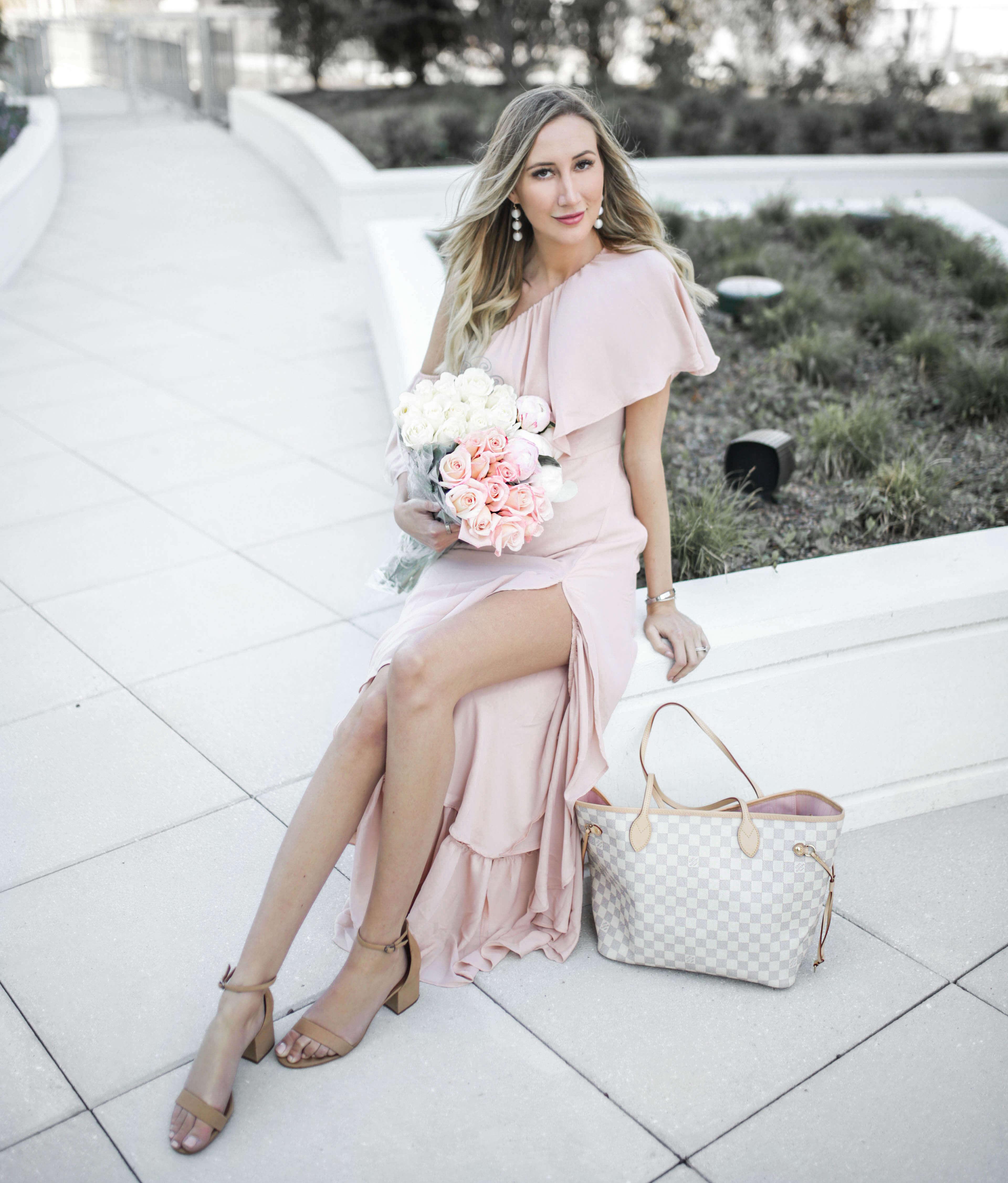 Carly Cristman wearing a Show Me Your Mumu blush ruffle gown, summer wedding guest gown, summer wedding outfit ideas, summer weddings
