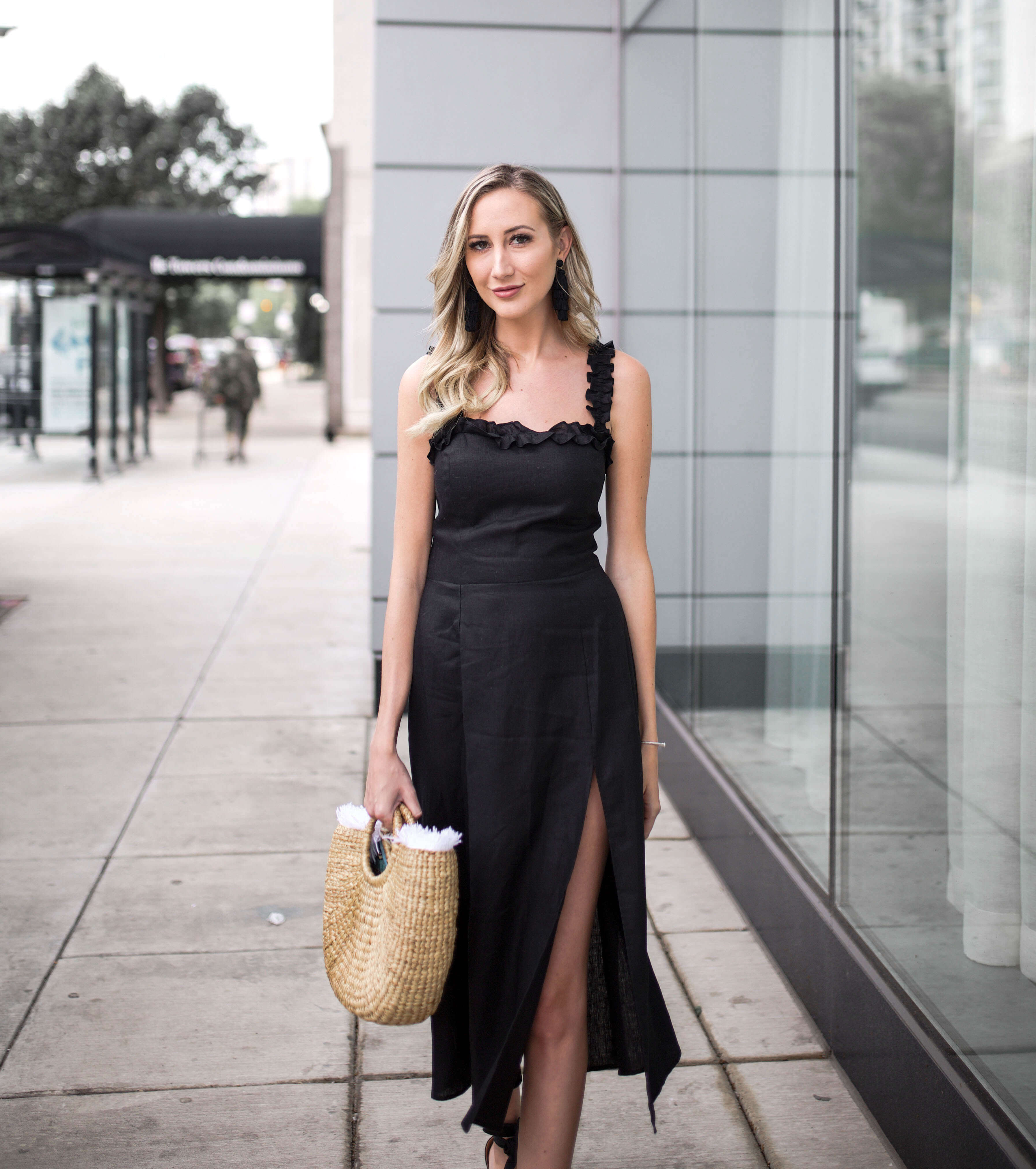 Carly Cristman, Chicago style blogger, wearing Reformation Lavender Dress with JadeTribe Basket Bag and black espadrille wedges. Summer wedding inspiration, summer outfit, little black dress for summer, summer date night dress